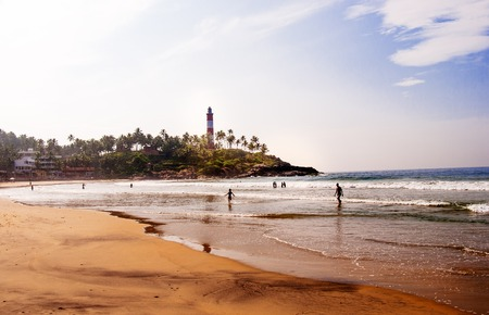 Lighthouse  and sea on Kovalam Beach, Kerala, India photo