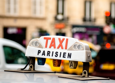 A Taxi in Paris waiting for customers photo