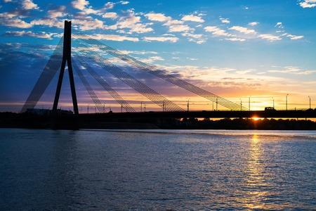 Sunset bridge river Daugava at sunset, Riga photo