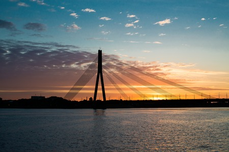 Sunset bridge river Daugava at sunset, Riga photo
