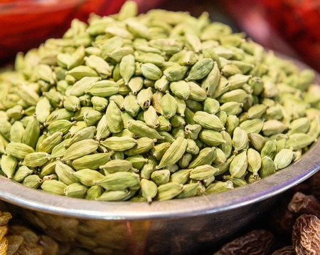 Cardamom seeds in a bowl on sale in a market place in India Stock Photo