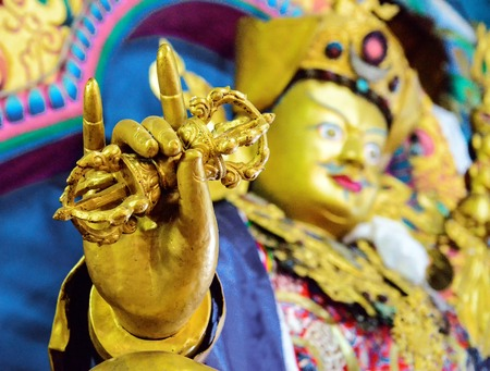 close up side view of maitreya Buddha sculpture in a monastery in  India photo