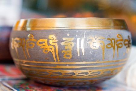 Brass singing bowl - a famous buddhist ritual object photo