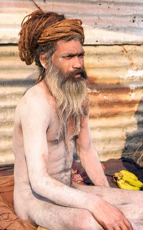 Allahabad, India- 25 January 2013: A Hindu sadhu sits in meditation during Kumbha Mela festival