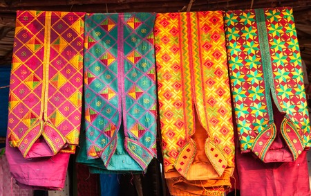 kurta: colorful kurta mens shirt at a market, India