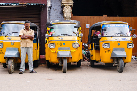 Trivandrum, India - December 11, 2011: Indian auto rickshaws in street. Auto rickshaws (called autos or tuk tuk) provide cheap transportation in indian cities instead of taxies for short distances Editorial