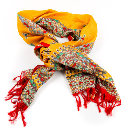textile industry: yellow indian silk scarf dupatta isolated