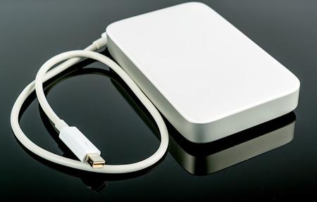 portable hard disc isolated on black photo