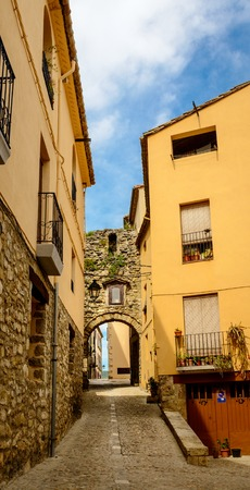 medeival: Narrow street with arch at end in medeival town of Besalu