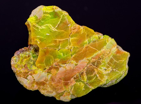phosphate: Raw Variscite - hydrated aluminium phosphate - from USA. Isolated on black background Stock Photo