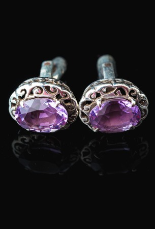 cufflinks: Cufflinks with amethyst in silver isolated on black Stock Photo