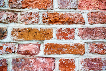 worn structure red: Old red brick wall close up, worn and rustic