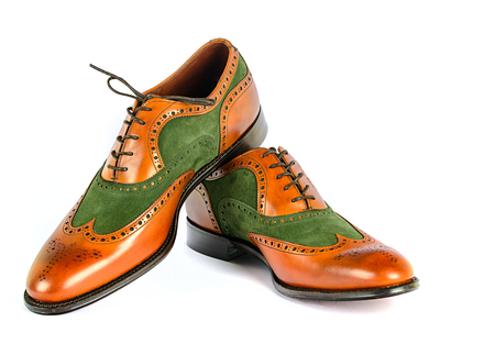 untied: Mens Spectator Style Dress Shoes isolated Green and Brown