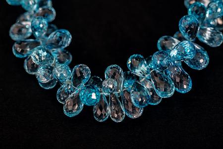 topaz: Blue topaz necklace fragment isolated on black background Stock Photo