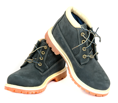 timberland: Pair of navy ladys boots with shoelace on white background.