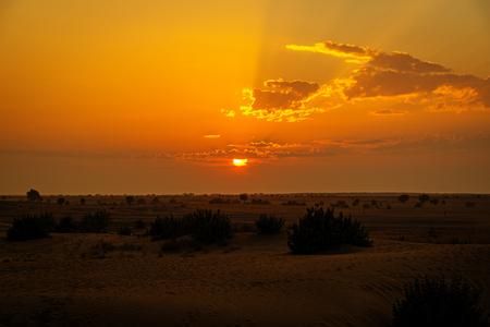 thar: Sun ball setting down over Thar desert, Rajasthan, India Stock Photo