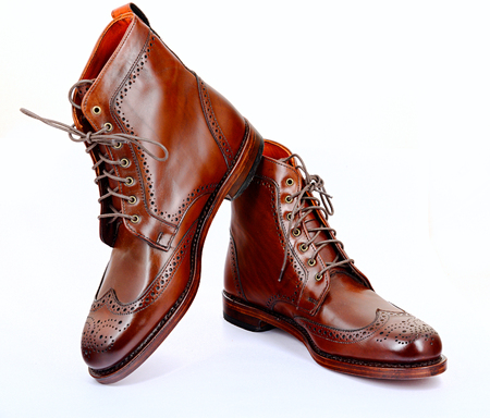 edmonds: Wingtip dark chili brown dress boots full size isolated on white background Stock Photo