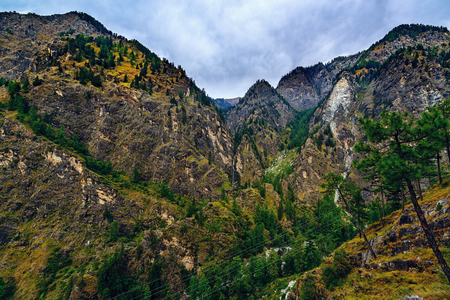 parvati: Parvati Valley mountains with waterfalls and grey clouds, North India Stock Photo