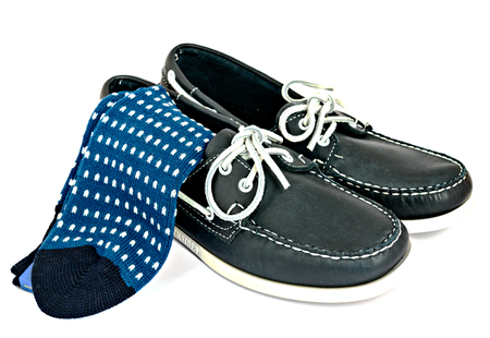 preppy: Blue Docksides deck shoes with hand-linked toes socks isolated on white