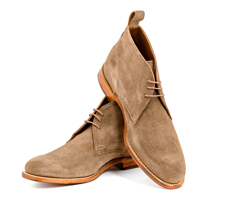 Mens almond suede boots isolated Stock Photo