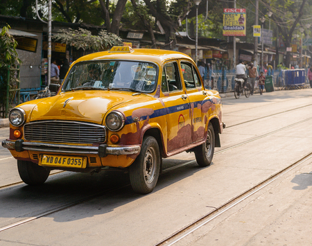 Yellow Ambassador Taxi in a street in Kolkata Editorial