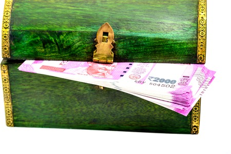 Vintage wooden casket from India with rupees notes