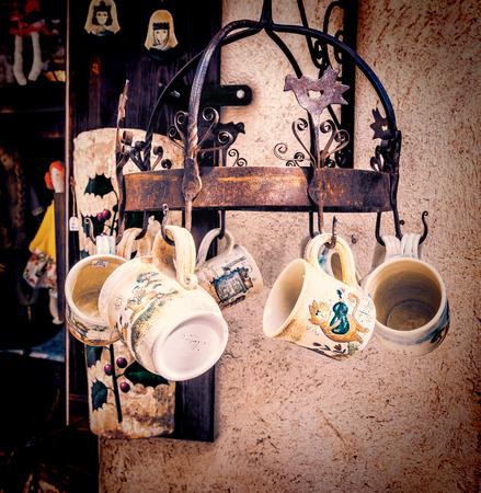Handmade ceramic mugs at street market in Besalu, Spain
