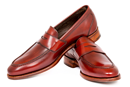 Pair of leather cherry calf penny loafer shoes together Stock Photo
