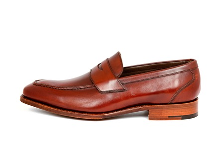 loafer: cherry calf penny loafer shoe toe to left Stock Photo