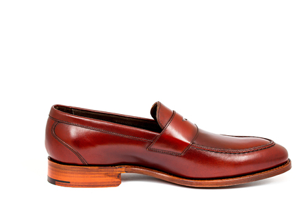 cherry calf penny loafer shoe toe to right Stock Photo