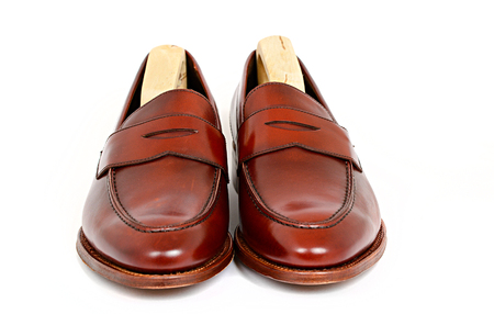 Pair of leather cherry calf penny loafer shoes with shoe tree inside