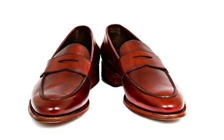loafer: Pair of leather cherry calf penny loafer shoes together at angle Stock Photo