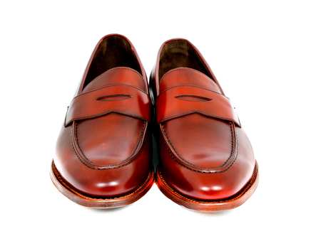 Pair of leather cherry calf penny loafer shoes together one by one closely