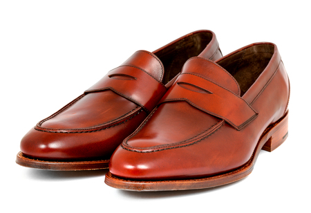 loafer: Pair of leather cherry calf penny loafer shoes together one by one diagonal left