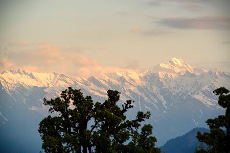 Chaukhamba peaks during sunrise from Deoria Tal lake