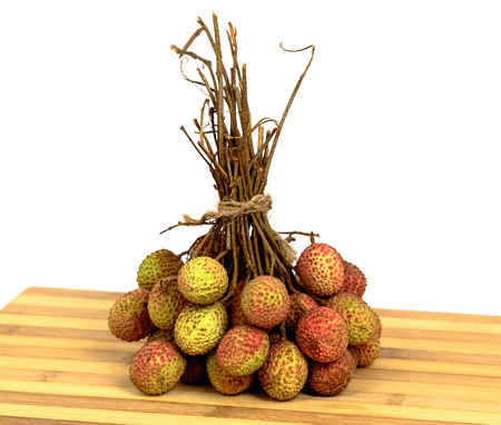 Bunch of lychee on old wooden cutting board
