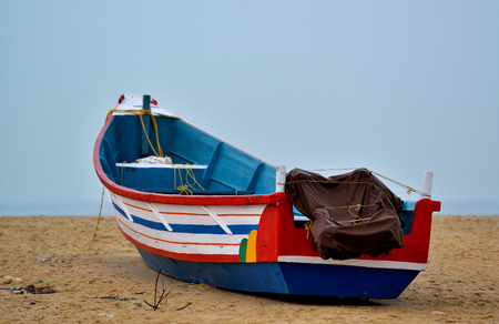 Traditional boat on sand beach, India Stock Photo