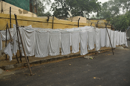 Sheets hanging at Dhobi Ghat - traditional laundry in India