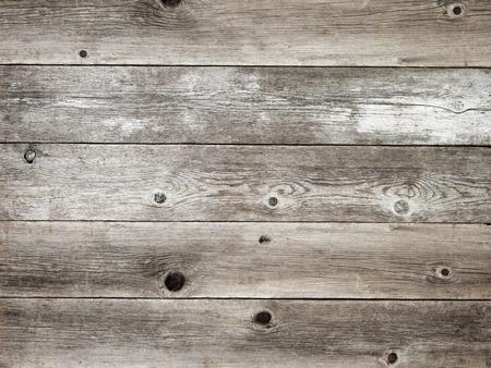 豊かな穀物と結び目を示す素朴なシルバーグレー風納屋の木製ボードの背景