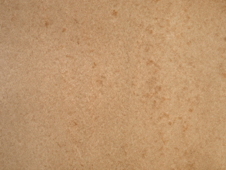 Smooth tan  brown mottled cardboard background with gradation
