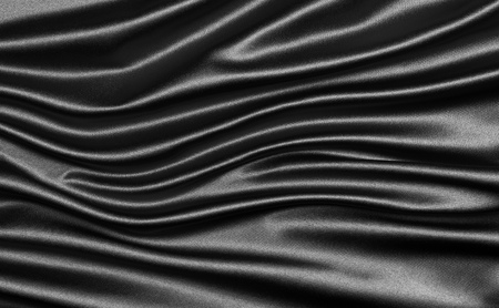 Luxurious elegant black silk or satin waves for abstract background