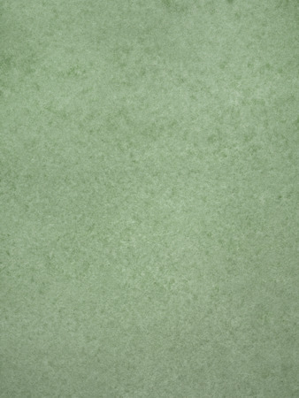Smooth green mottled cardboard background