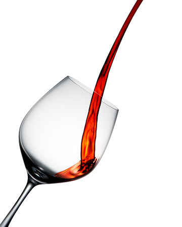 Red wine poured into elegant wine glass isolated on white