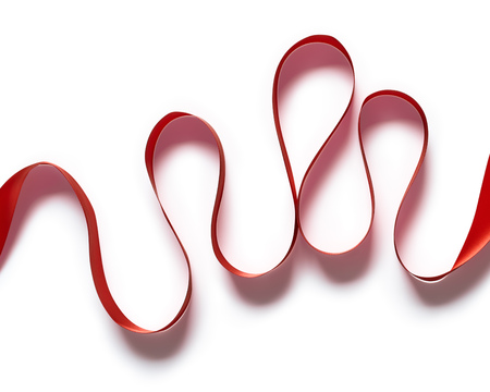 Red silk or satin ribbon abstraction isolated on white background