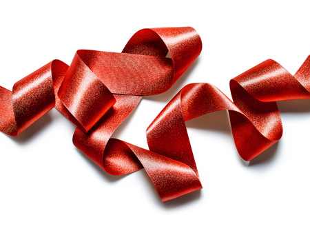 Close up of red metallic ribbon isolated on white background Stock Photo