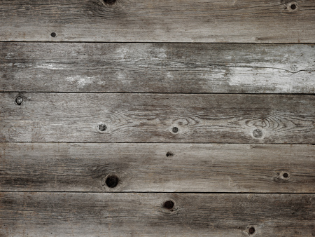 Rustic silver grey weathered barn wood board background showing rich grain and knots Banco de Imagens