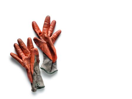 Dirty worn orange rubber coated work gloves on white Stock Photo