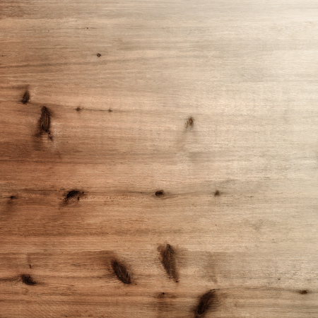 Rustic warm light brown wood board background with knots and grain gradation Banco de Imagens