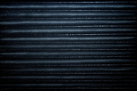 Dark blue corrugated metallic texture industrial abstract pattern background with ridges Stock Photo