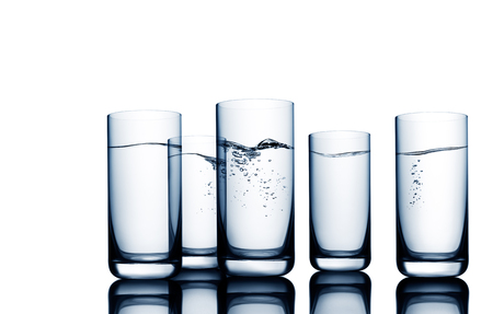 Conceptual illustration of water wave and bubbles seen through water glasses on white Фото со стока